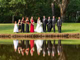 Wedding party reflecting in lake